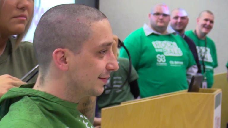 CSL Behring employee getting head shaved.