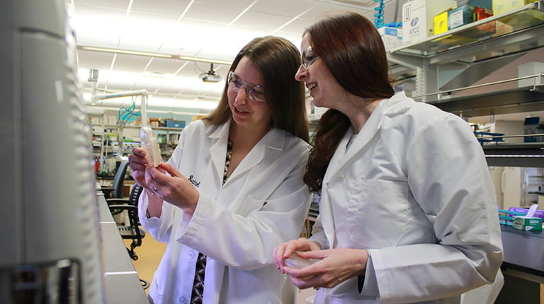 Calvin College professors Rachael Baker (left) and Amy Wilstermann conduct research in a laboratory on the school's campus in Grand Rapids, Michigan.