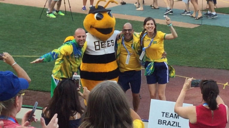 Transplant Games participants standing with bee mascot