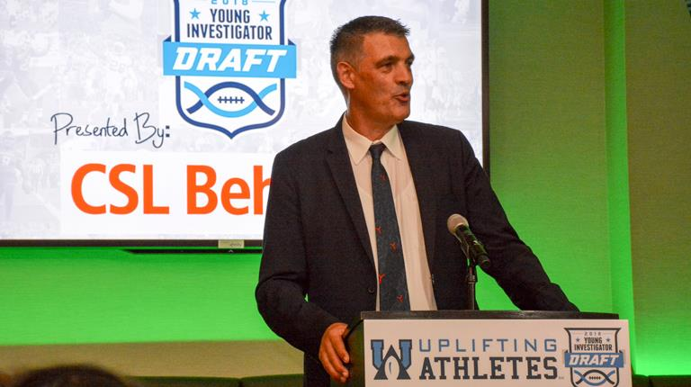 Jens Oltrogge speaking at Uplifting Athletes Young Investigator Draft presented by CSL Behring.