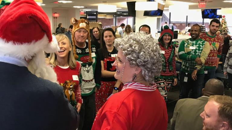"""""""Santa"""" and """"Mrs. Claus"""" served as emcees of an ugly sweater contest at CSL Behring in King of Prussia, Pa. The event supported the Philadelphia Ronald McDonald House, which supports families of seriously ill children by creating a community of comfort and hope."""