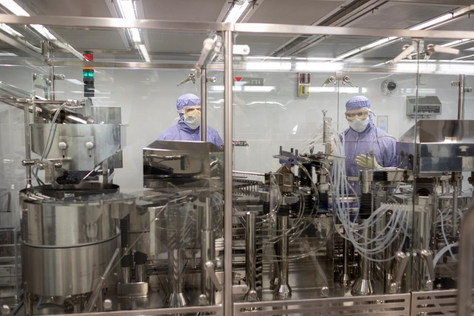 Workers fill vials at CSL Behring Kankakee, Illinois, manufacturing site
