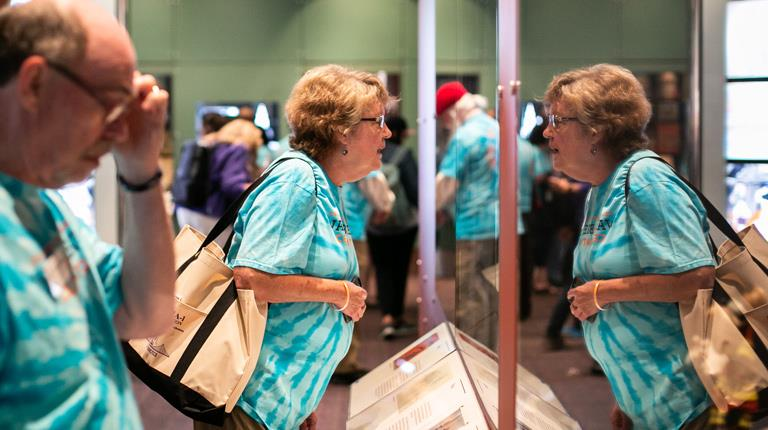 An attendee at CSL Behring's Walk For Breath event looks at an exhibit at the Walt Disney Family Museum in San Francisco
