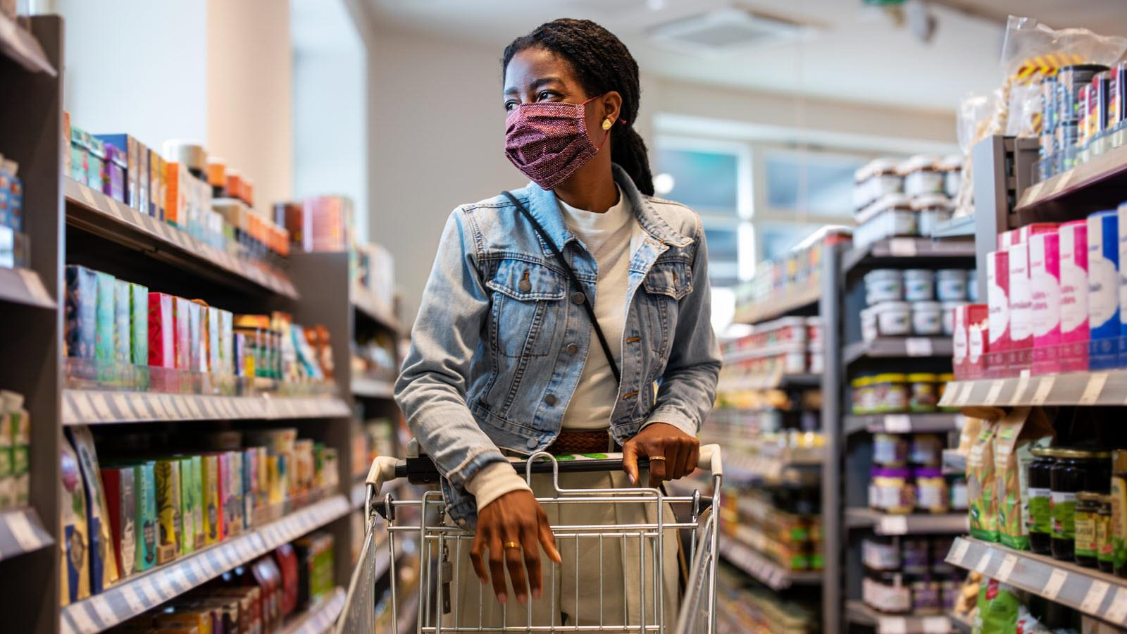 woman in grocery store wearing a mask