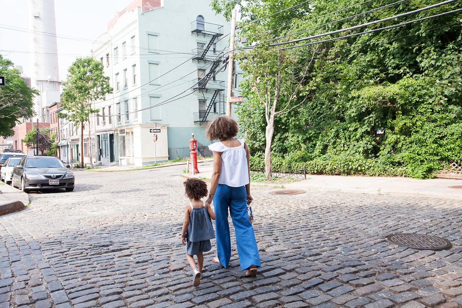 Mother and child walking on the street