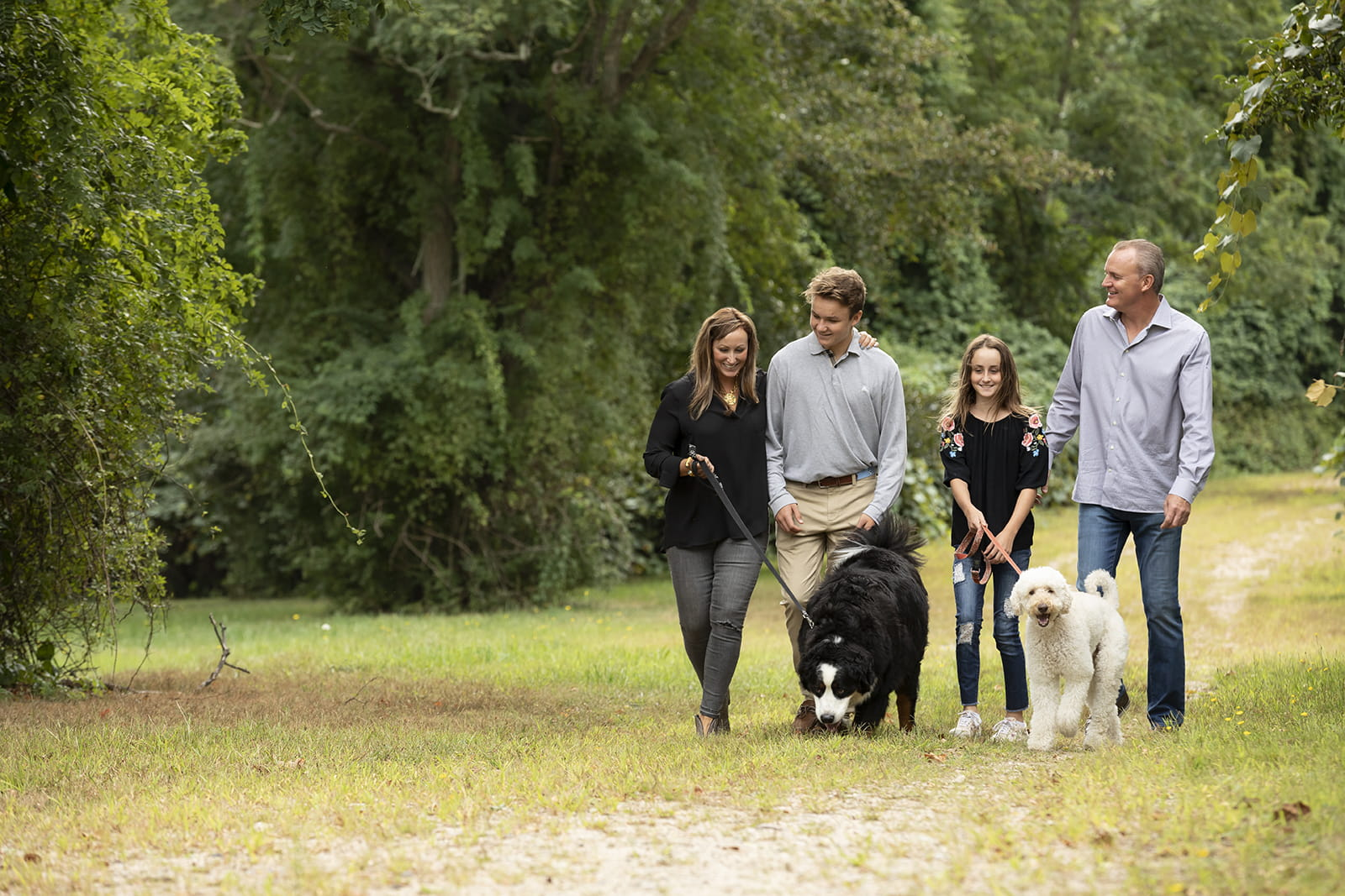 Logan and his family walking their dogs