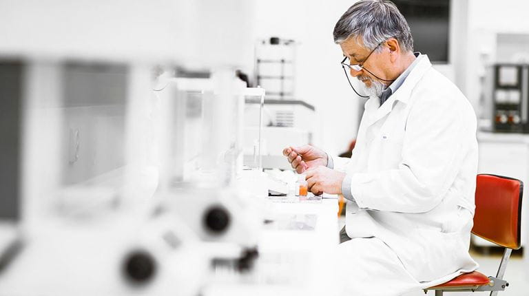 Mature man seated in a lab