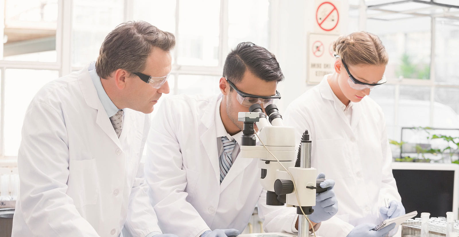 three researchers in a lab