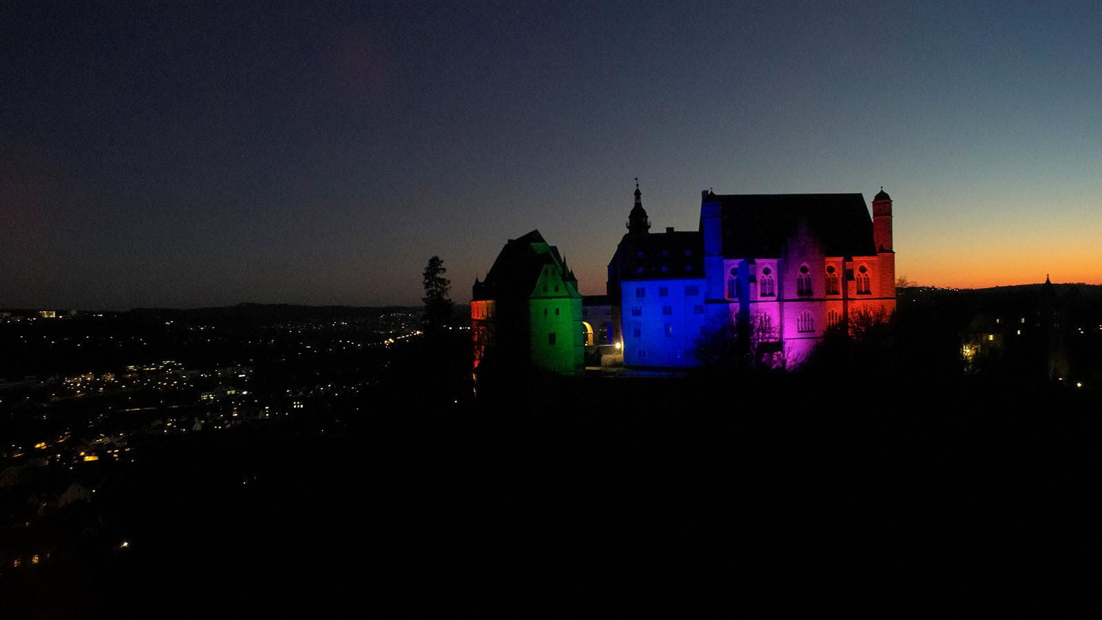 Marburg Castle lit up in the colors of Rare Disease Day.