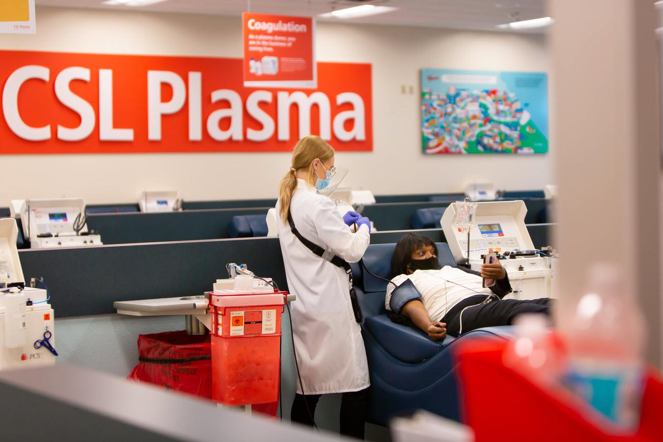 A plasma donor looks at her phone while donating at a CSL Plasma center.