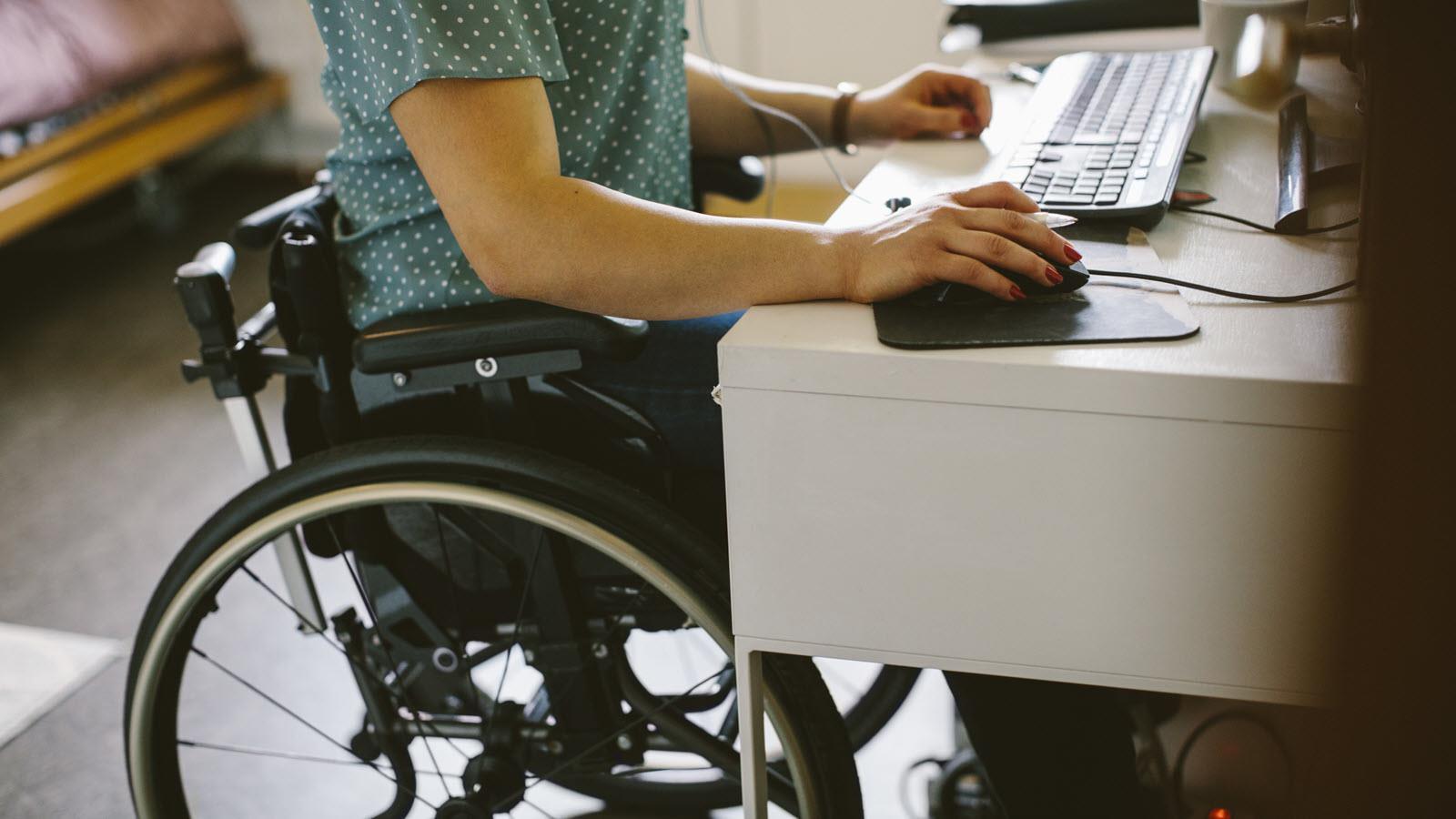 employee in a wheelchair while working at a desk