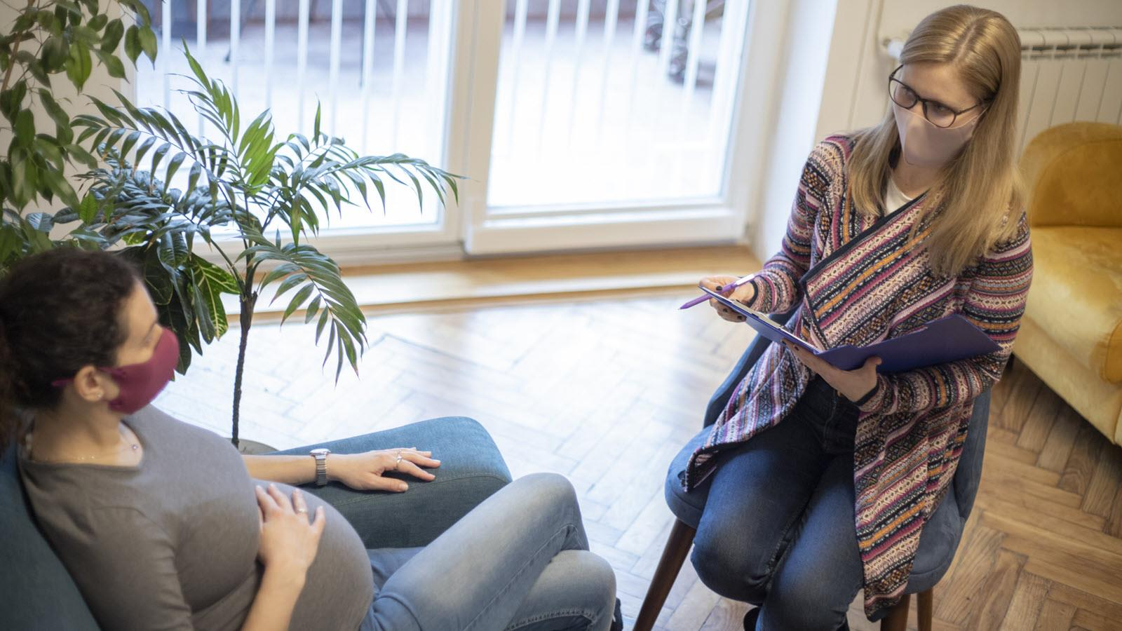 genetic counselor talks with a pregnant patient