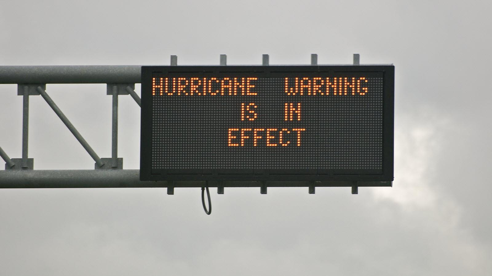 Highway sign that says Hurricane Warning in Effect
