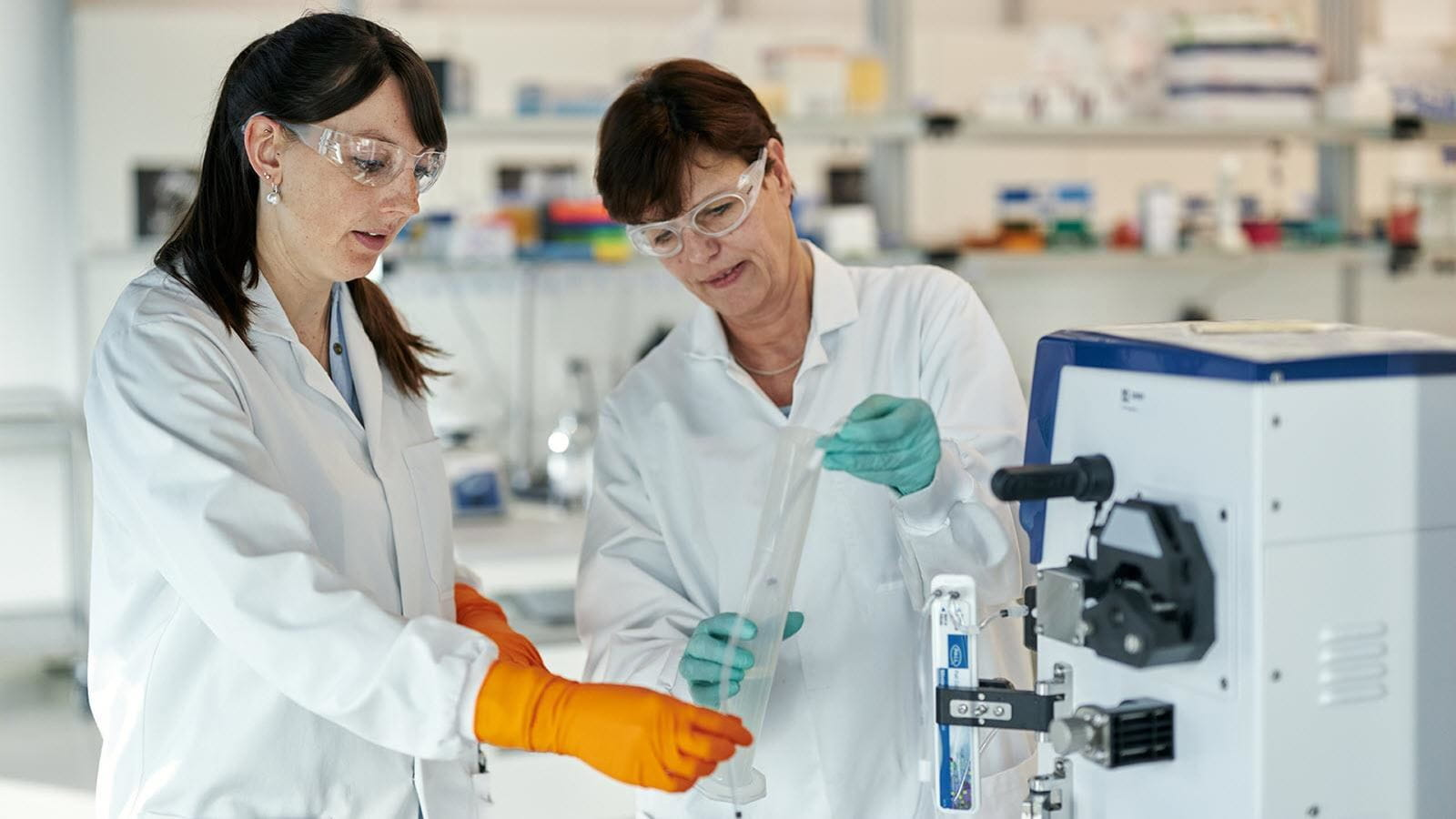Two scientists at work in the lab.