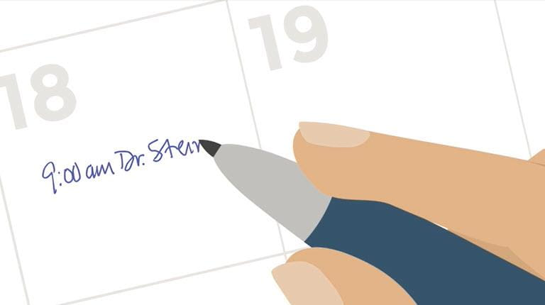 hand writing an appointment on a calendar