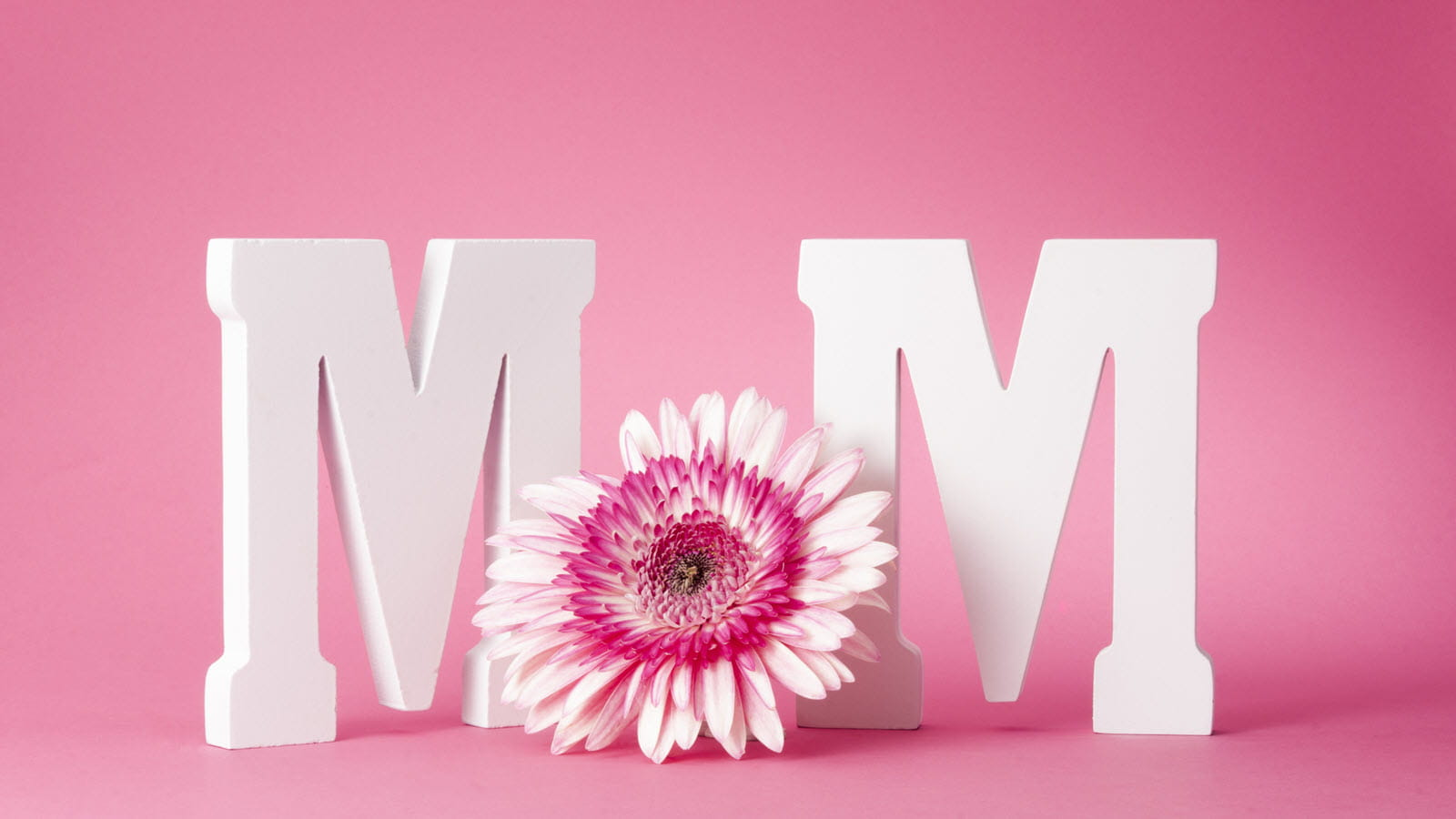 Mom in white letters with flower
