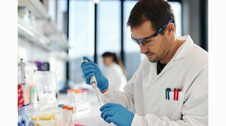 scientist injects solution into test tube