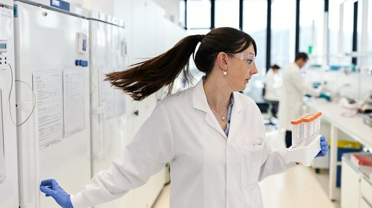 scientist turns in the lab with her ponytail flying behind her