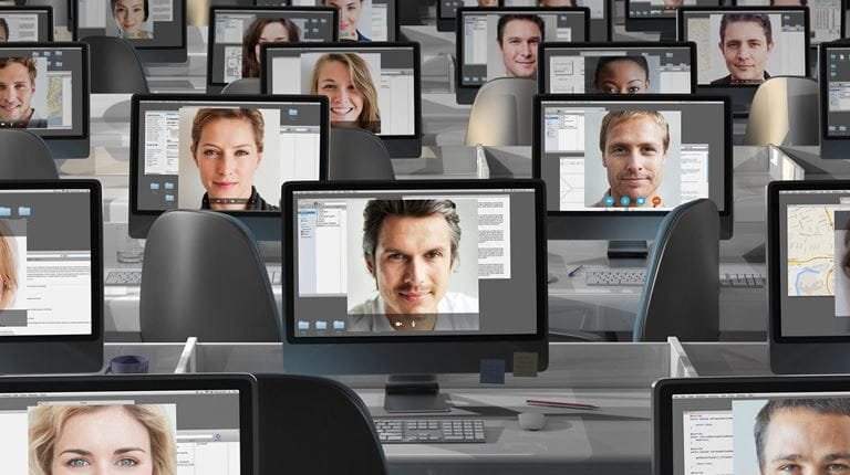 Multiple screens with video meeting attendees